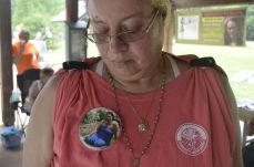 Lois Roberts, of Staunton, wears a button for Bonnie Santiago, her ex mother-in-law, who has been missing for more than a year now. Roberts volunteers as an outreach coordinator in Virginia for the CUE Center for Missing Persons. (Michael Bragg | The Daily Progress)
