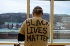 Forrest Yerman, graduate student in the Appalachian Studies program at Appalachian State University, wears his handmade Black Lives Matter T-shirt. (Michael Bragg | The Appalachian)